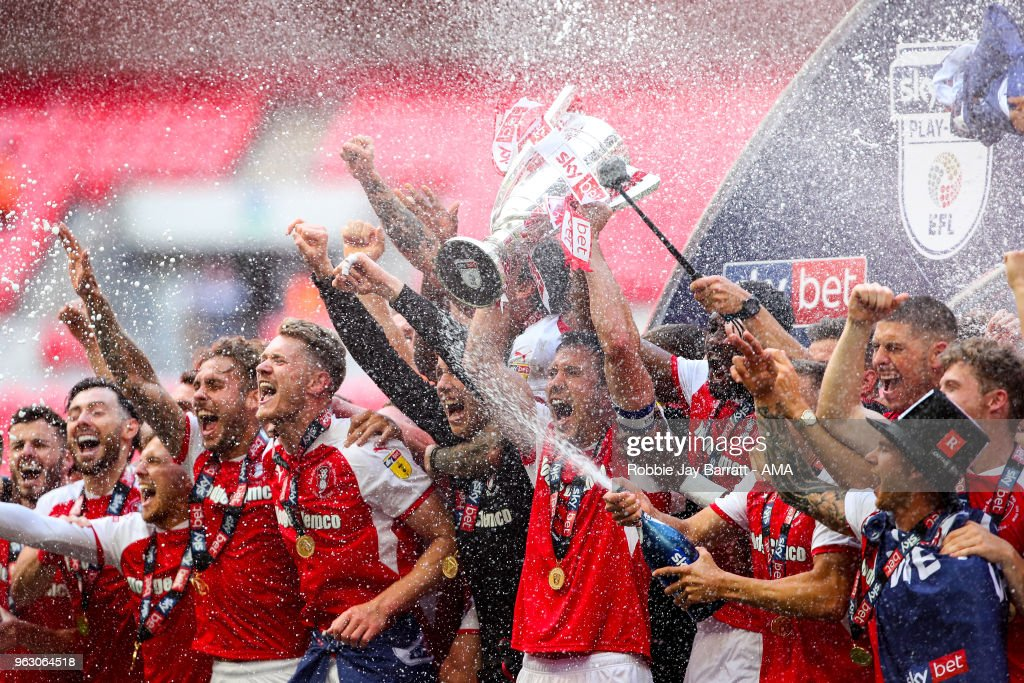 Rotherham United celebrate by lifting the EFl Sky Bet Championship League One play off trophy during the Sky Bet League One Play Off Final between Rotherham United and Shrewsbury Town at Wembley Stadium on May 27, 2018 in London, England.