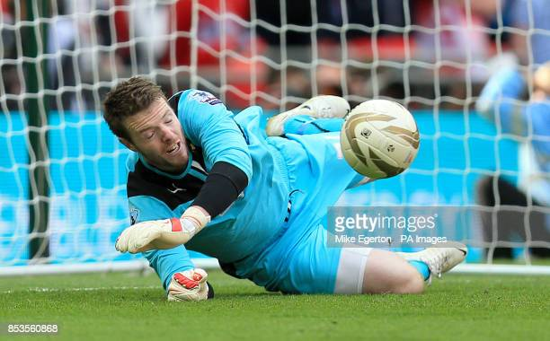 Rotherham United goalkeeper Adam Collin saves the deciding penalty from Leyton Orient's Chris Dagnall in the shootout