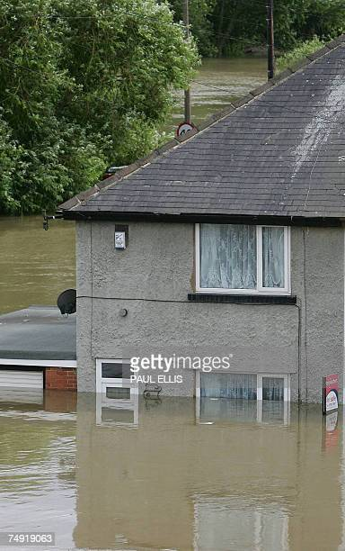 A house in the Catcliffe area of Sheffield is submerged in flood waters 26 June 2007 as the level of river water continued to rise across South...
