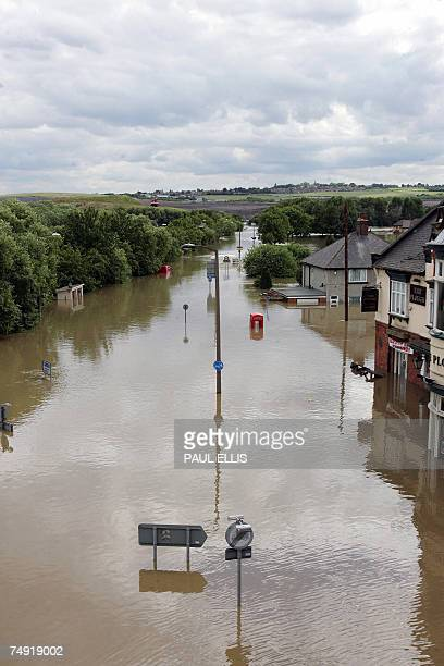 The main road through the Catcliffe area of Sheffield is submerged in flood waters 26 June 2007 as the level of river water continued to rise across...