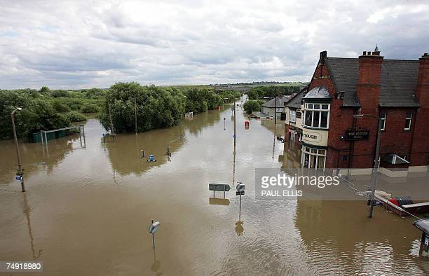The Plough a public house in the Catcliffe area of Sheffield is submerged in flood waters 26 June 2007 as the level of river water continued to rise...