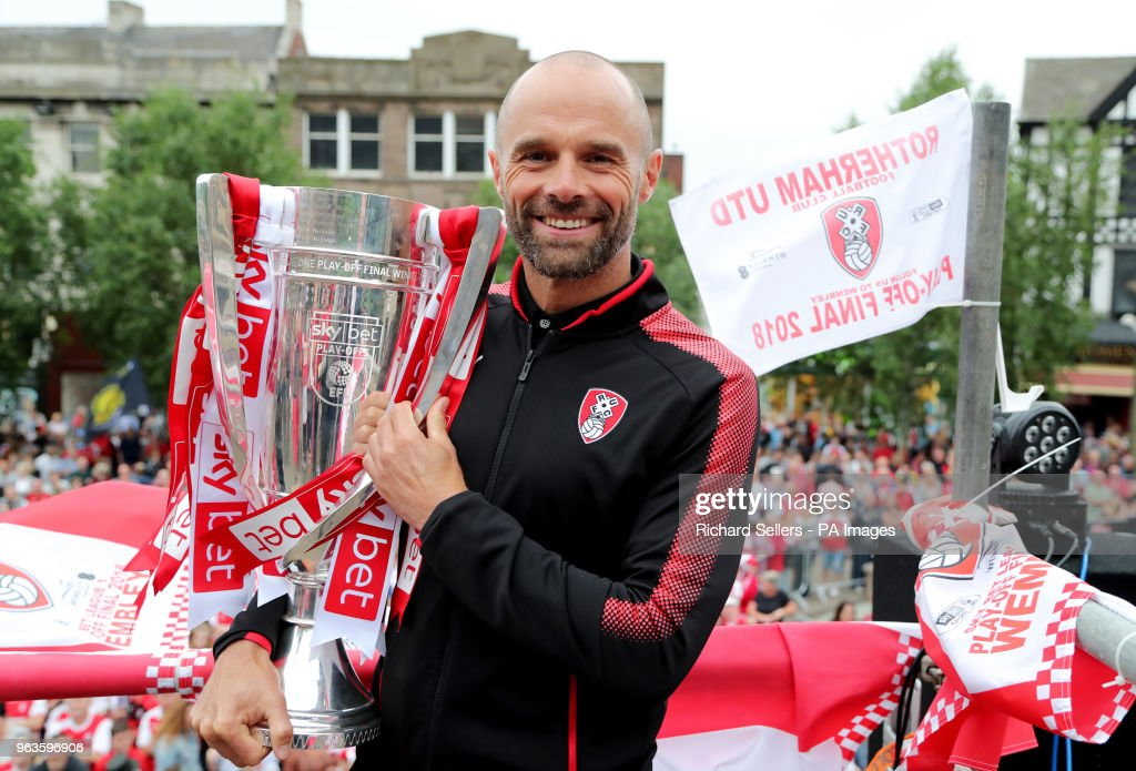 Rotherham United manager Paul Warne with the trophy during the League One promotion parade in Rotherham.