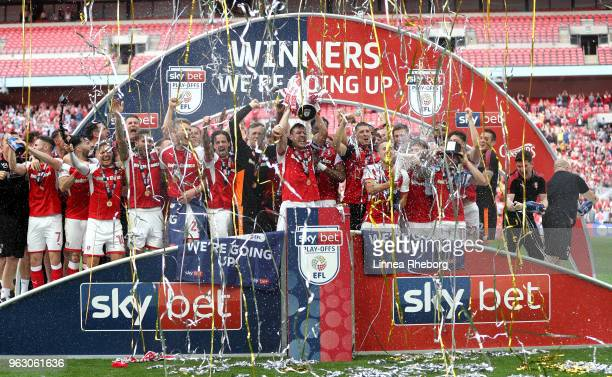 Rotherham United players celebrate victory with the trophy after the Sky Bet League One Play Off Final between Rotherham United and Shrewsbury Town...