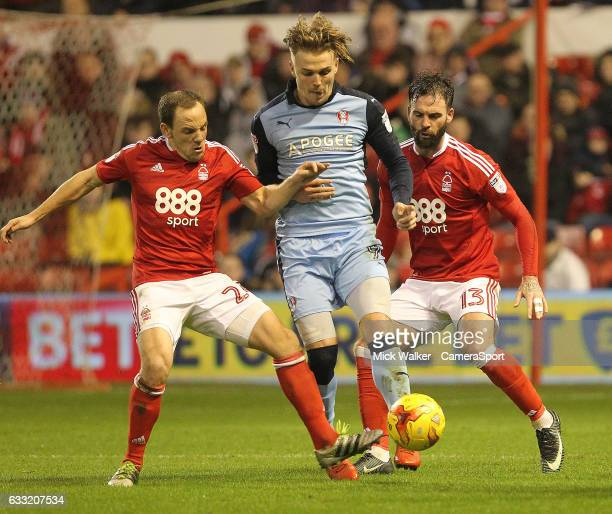 Rotherham United's Danny Ward battles with Nottingham Forest's David Vaughan and Danny Fox during the Sky Bet Championship match between Nottingham...