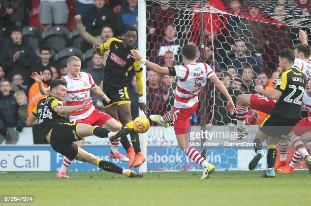 Rotherham United's Kieffer Moore scores his sides first goal to equalise in injury time during the Sky Bet League One match between Doncaster Rovers...