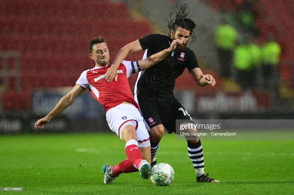 Rotherham United's Lee Frecklington vies for possession with Lincoln City's Michael Bostwick during the Carabao Cup First Round match between Rotherham United and Lincoln City at Millmoor Ground on August 8, 2017 in Rotherham, England.