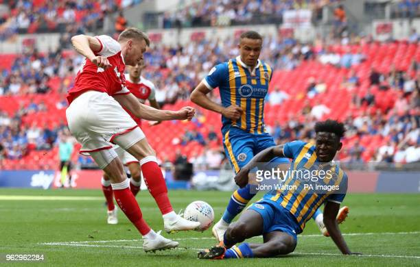 Rotherham United's Michael Smith and Shrewsbury Town's Aristote Nsiala during the Sky Bet League One Final at Wembley Stadium London