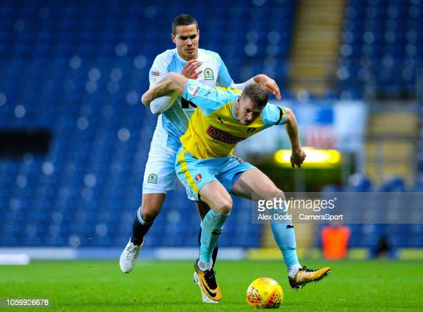 Rotherham United's Michael Smith holds off the challenge from Blackburn Rovers' Jack Rodwell during the Sky Bet Championship match between Blackburn...