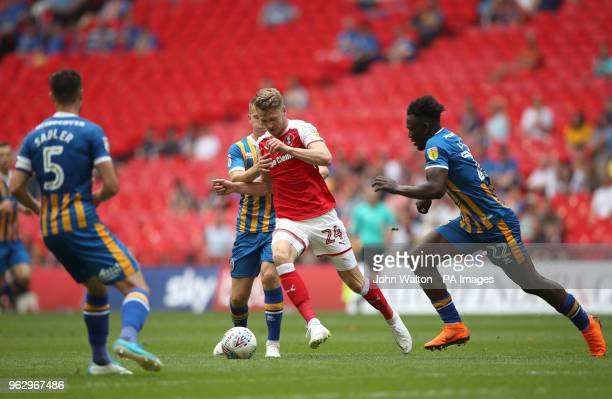 Rotherham United's Michael Smith under pressure from Shrewsbury Town's Aristote Nsiala during the Sky Bet League One Final at Wembley Stadium London