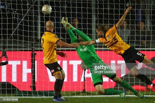 Rotherham's Slovakian goalkeeper Marek Rodak cannot spot a shot from Leicester City's Algerian midfielder Rachid Ghezzal making the score 11 during...