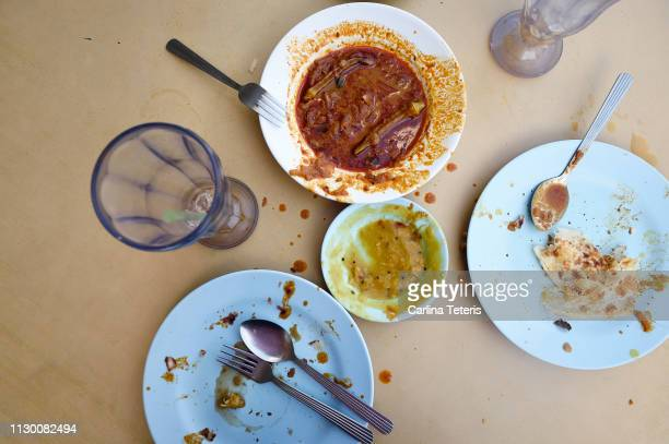 roti canai breakfast table mess - curry meal stock pictures, royalty-free photos & images