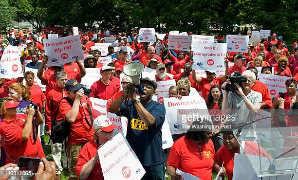 Rotimi Onaghise C holding bullhorn leads a chant where hundreds of Veterans Affairs workers members of the American Federation of Government...