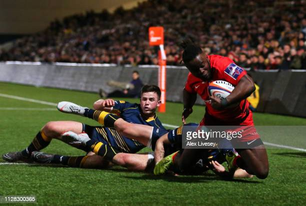 Rotimi Segun of Saracens beats the tackle as he touches down to score their seond try during the Premiership Rugby Cup semi-final match between...