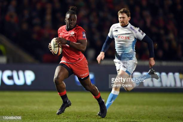 Rotimi Segun of Saracens gets past Simon Hammersley of Sale Sharks to score a try during the Premiership Rugby Cup SemiFinal match between Sale...