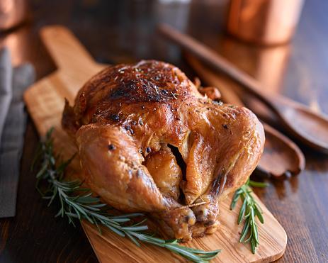 rotisserie chicken with herbs 594461740