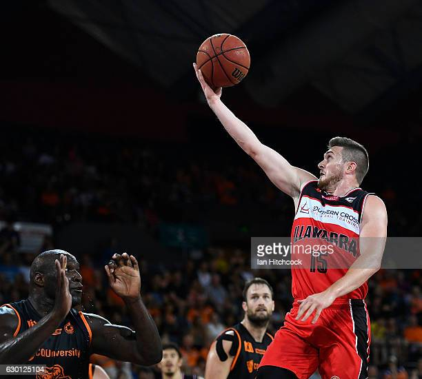 Rotnei Clarke of the Hawks attempts a lay up over Nathan Jawai of the Taipans during the round 11 NBL match between Cairns and Illawarra on December...