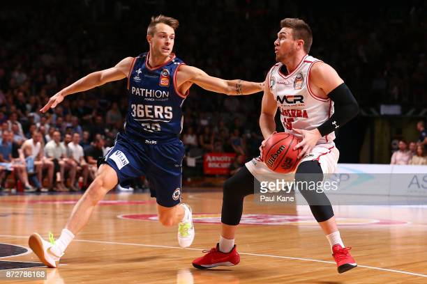 Rotnei Clarke of the Hawks controls the ball against Nathan Sobey of the 36ers during the round six NBL match between the Adelaide 36ers and the...
