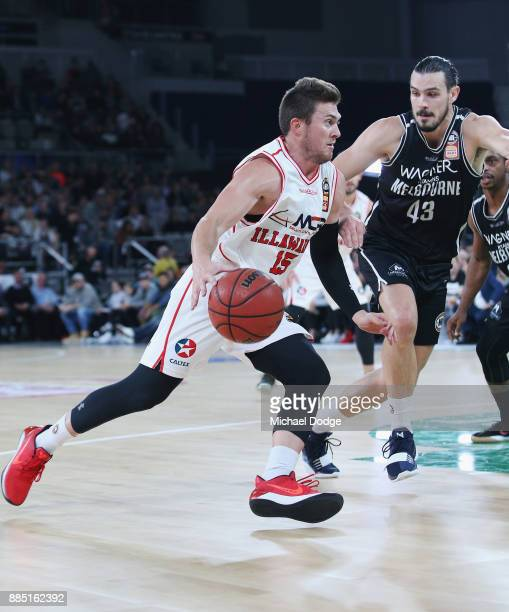 Rotnei Clarke of the Hawks drives hard against Chris Goulding of United during the round eight NBL match between Melbourne United and the Illawarra...