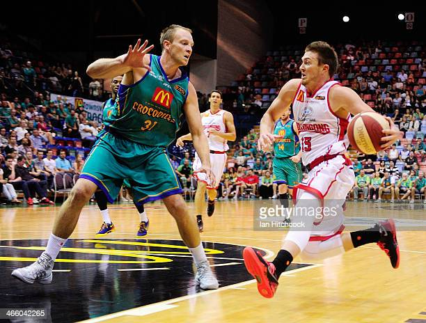 Rotnei Clarke of the Hawks drives to the basket past Jacob Holmes of the Crocodiles during the round 16 NBL match between the Townsville Crocodiles...