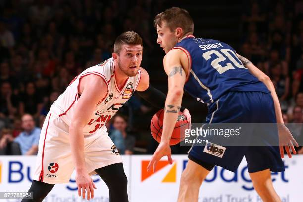 Rotnei Clarke of the Hawks works the ball against Nathan Sobey of the 36ers during the round six NBL match between the Adelaide 36ers and the...