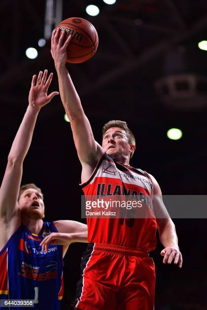 Rotnei Clarke of the Illawarra Hawks shoots over Matthew Hodgson of the Adelaide 36ers during game three of the NBL Semi Final series between the...