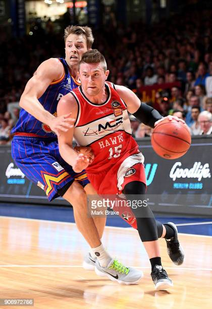 Rotnei Clarke of the Illawarra Hawks takes on Nathan Sobey of the Adelaide 36ers during the round 15 NBL match between the Adelaide 36ers and the...