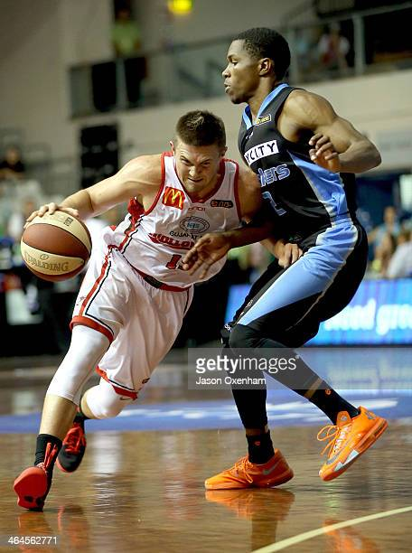 Rotnei Clarke of the Wollongong Hawks charges into Kerron Johnson of the Breakers during the round 15 NBL match between the Perth Wildcats and the...