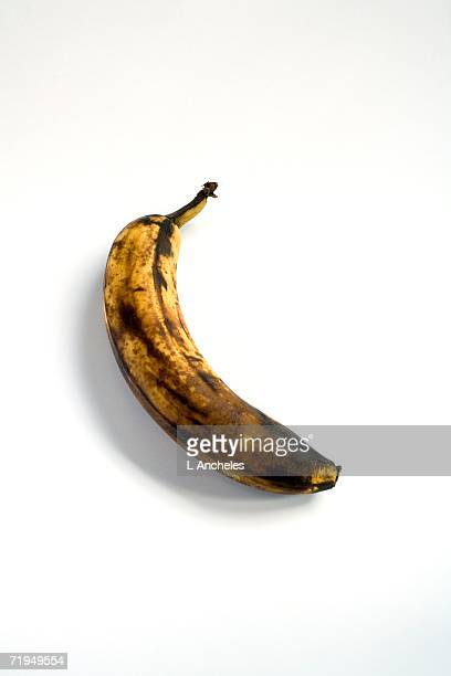 A rotten banana on a white background.