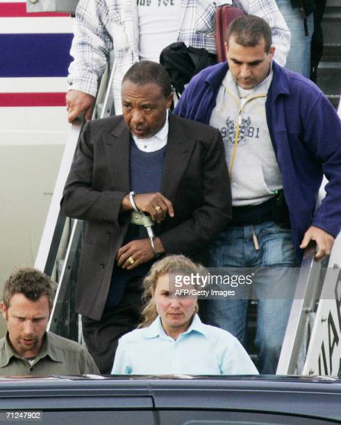 Former Liberian President Charles Taylor arrives at Rotterdam Airport 20 June 2006 for his war crimes trial before the Special Court of Sierra Leone...