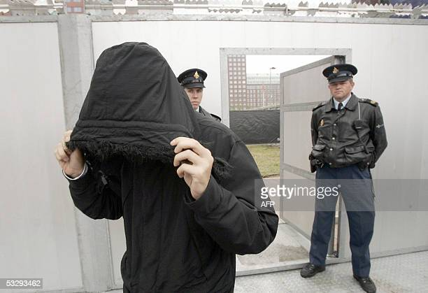 Samir A one of the alleged members of the Hofstad group covers his face as he leaves the courthouse in Rotterdam The Netherlands 27 July 2005 Several...