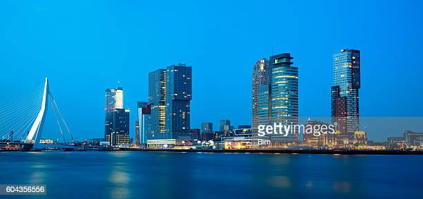 rotterdam, skyline illuminated at dusk, netherlands, panoramic view - skyline stock pictures, royalty-free photos & images