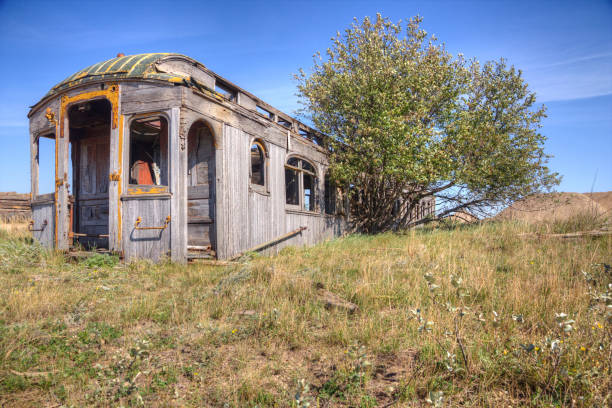 Rotting Pullman railway car in a field