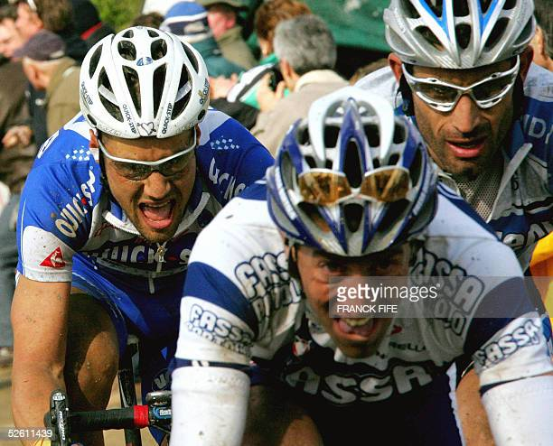 Belgian Tom Boonen Spanish Juan Antonio Flecha and US George Hincapie ride in the leading pack during the 103rd ParisRoubaix cycling race 10 April...
