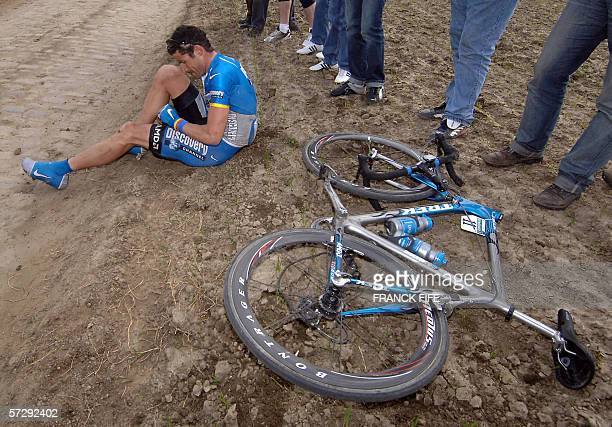 Us cyclist Georges Hincapie is pictured after he fell down during the 104th ParisRoubaix cycling classic race between Compiegne and Roubaix 09 April...