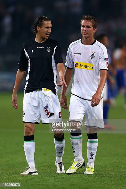 Rouel Brouwers and Luuk de Jong of Moenchengladbach look dejected after losing 13 the UEFA Champions League playoff first leg match between Borussia...