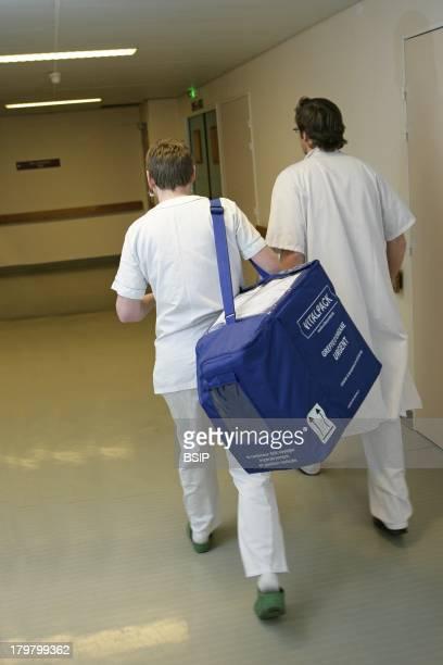 Rouen hospital France Cardiac transplantation heart transplant The coordinating nurse brings the transplant to the surgeon