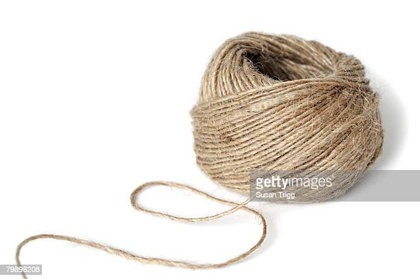 Rough ball of twine on white background
