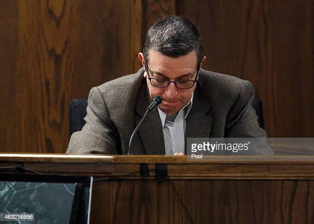 Rough Creek Lodge and Resort manager Frank Alvarez bows his head after viewing gruesome photos of the shooting scene during the capital murder trial...
