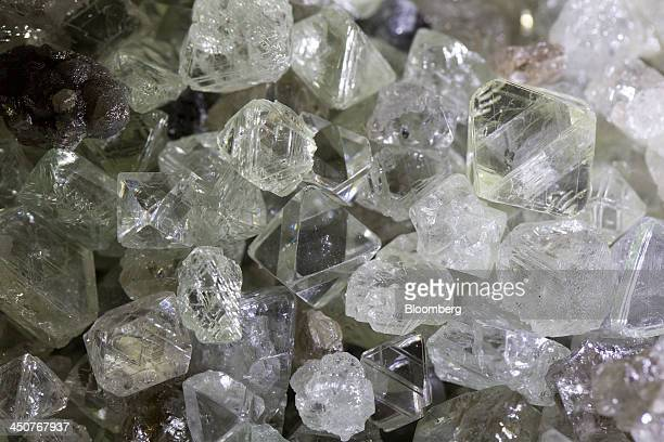 Rough cut diamonds sit during processing in the sorting center at OAO Alrosa's Mir diamond mine in Mirny Russia on Thursday Nov 14 2013 OAO Alrosa...