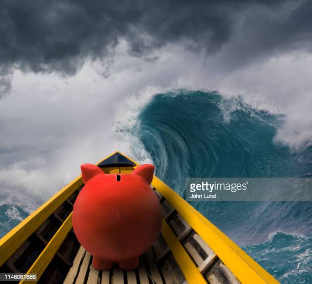 rough financial seas piggy bank - adversidade imagens e fotografias de stock