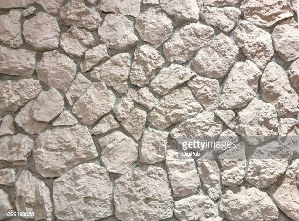 rough irregular shape  white stone wall - irregular texturizado stock pictures, royalty-free photos & images