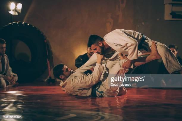 rough martial arts practice - taekwondo stock photos and pictures