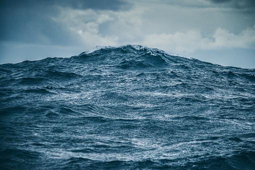 Rough ocean details: sea waves pattern 1051147620