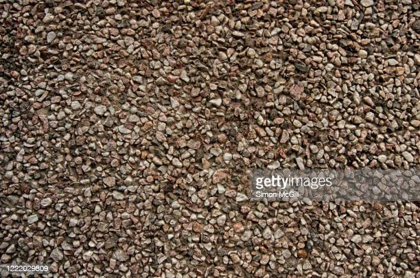 rough pebblecrete wall made from exposed aggregate pebbles and cement - pebble stock pictures, royalty-free photos & images