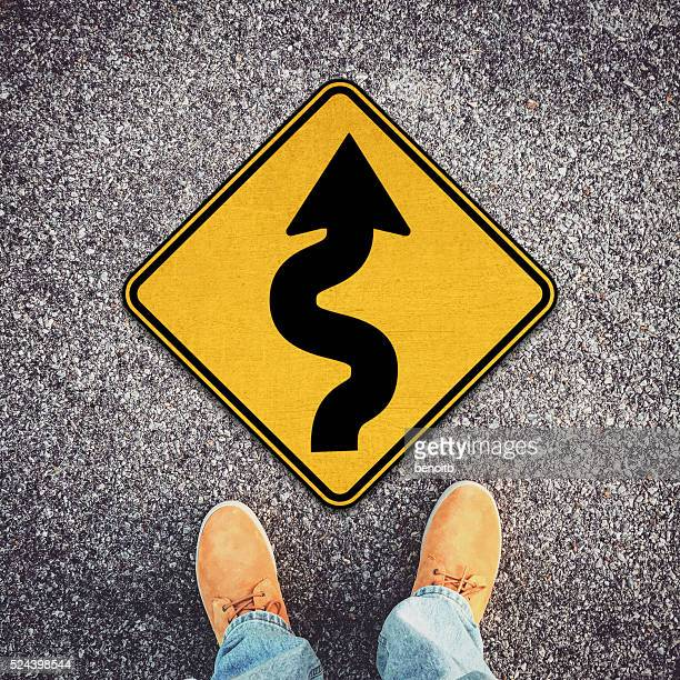 rough road ahead - curved arrows stock photos and pictures