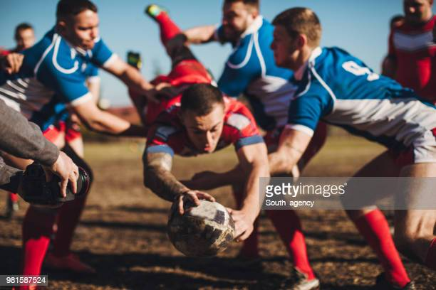 rough rugby game - tackling stock pictures, royalty-free photos & images