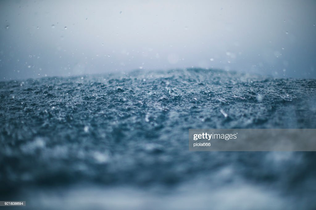 Rough sea and rain drops : Stock Photo