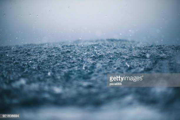rough sea and rain drops - torrential rain stock pictures, royalty-free photos & images