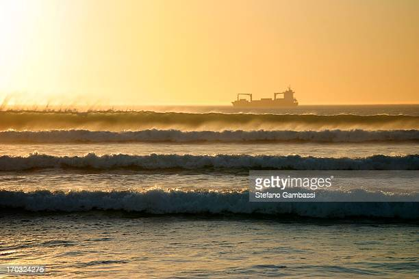 CONTENT] Rough sea in Cape Town with cargo boat at sunset