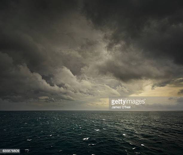 rough sea - moody sky stock pictures, royalty-free photos & images